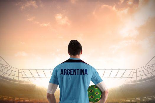Argentina football player holding ball