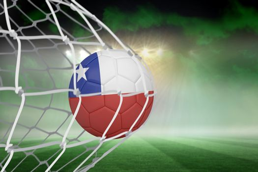 Football in chile colours at back of net