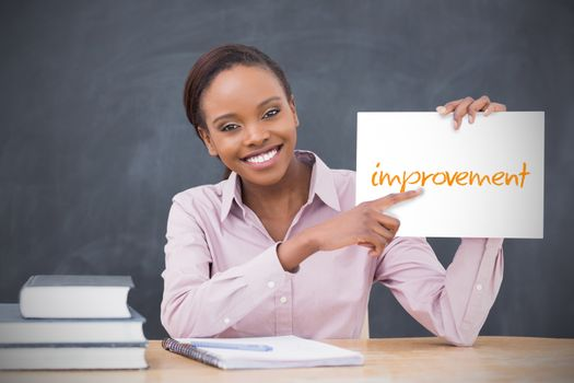 Happy teacher holding page showing improvement