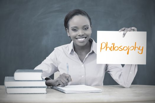 Happy teacher holding page showing philosophy