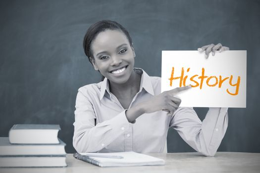 Happy teacher holding page showing history