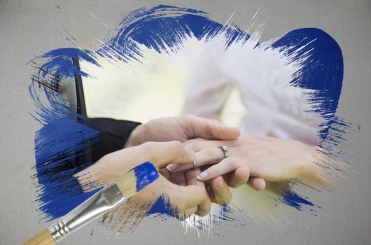 Composite image of groom placing ring on brides finger with paintbrush dipped in blue against digitally generated grey background