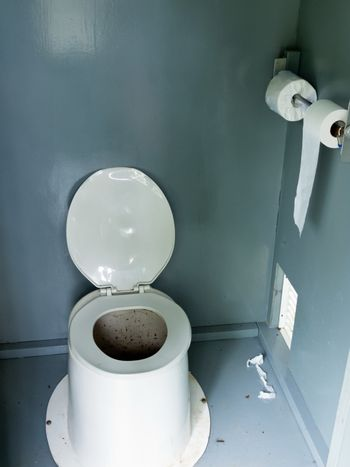 Filthy camp ground latrine outhouse inside toilet