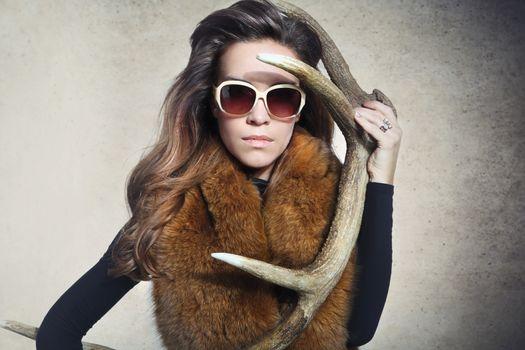An elegant woman with a horn deer