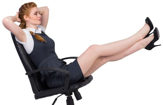 Businesswoman sitting on swivel chair