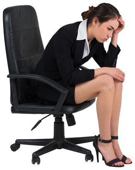 Worried businesswoman on swivel chair