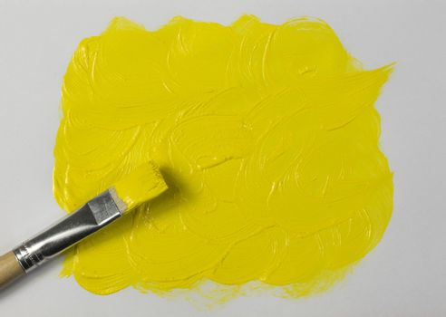 Yellow paint with paintbrush