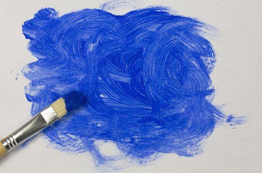 Blue paint with paintbrush