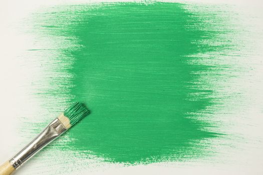 Green paint with paintbrush