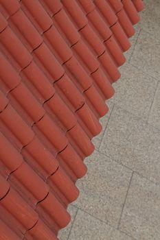 Slanted terracota tiled awning mosaic floor backdrop