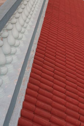 Classic style cast  cement balustrade slanted red terracota tiles awning
