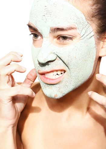 impatient woman in the mask with green clay