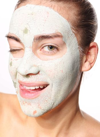 girl in the mask with green clay
