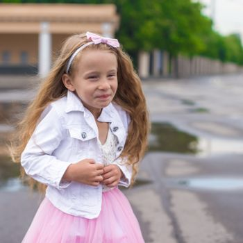 Outdoor portrait of little girl in princess dress