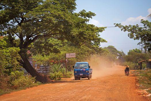Truck on dusty road in Treak village, Siem Reap