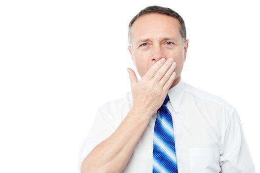 Bored senior executive yawning