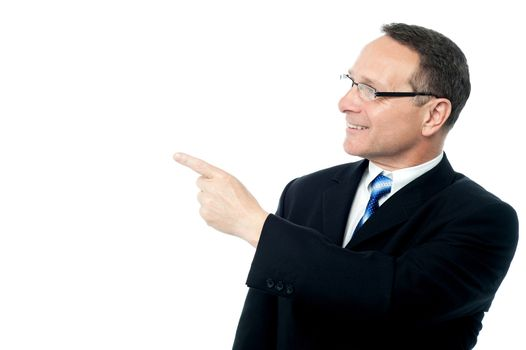 Handsome businessman pointing away