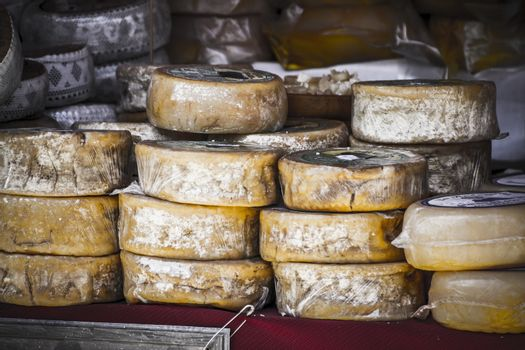 artisan food stalls, cheese, meat, stuffed into a medieval fair