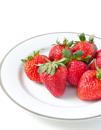Ripe strawberries in a porcelain plate