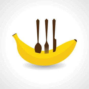 A fork,knife and spoon on the fresh banana stock vector