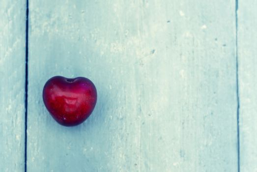 Photo of red heart shape cherry