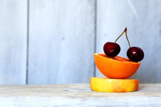 Summer photo of sliced apple, orange and cherry