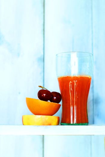 This is a photo of fruits and orange juice