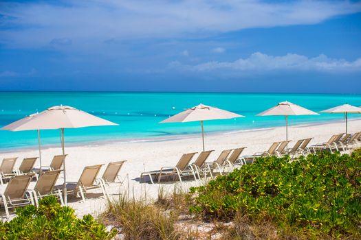 Lounges under an umbrella on sandy beach