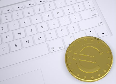 Gold euro coin on the keyboard