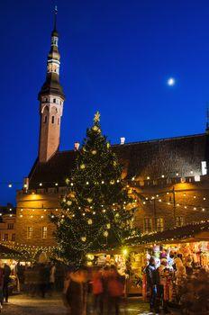 TALLINN, ESTONIA -JANUARY 05: People enjoy Christmas market in Tallinn on January 05, 2014 in Tallinn , Estonia. It is Estonia oldest Christmas Market with a very long history dating back to 1441.