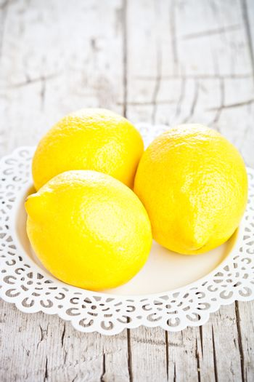 three fresh lemons