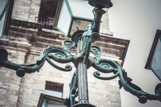 outdoor, traditional street lamp with decorative metal flourishes