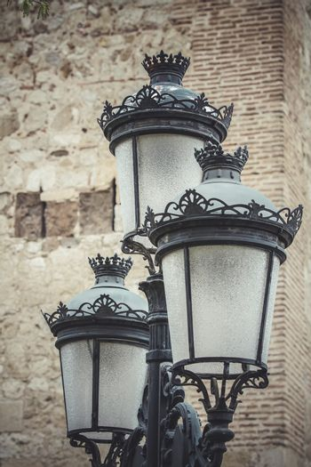 europe, traditional street lamp with decorative metal flourishes