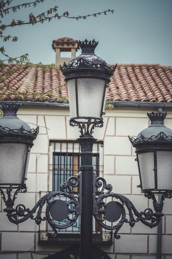 Lamppost, traditional street lamp with decorative metal flourishes