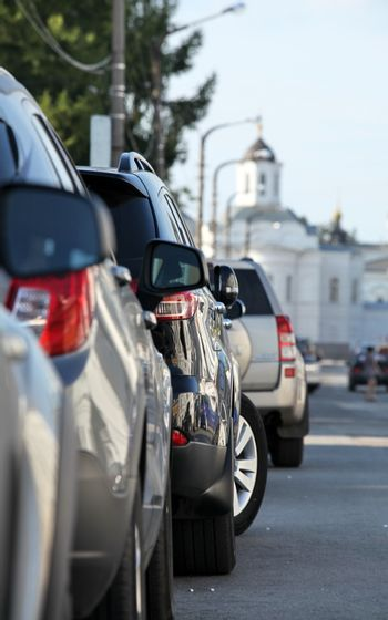 Street with long row of cars parked in St. Petersburg
