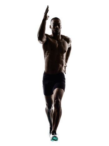 young african muscular build man jumping running  silhouette