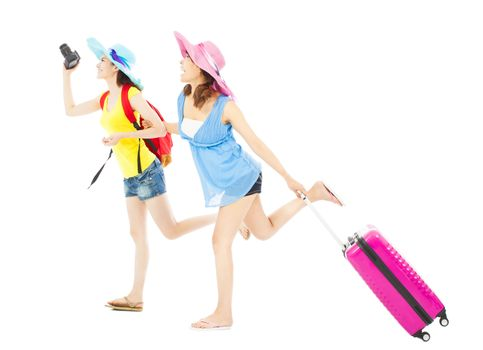 two female backpackers happy to travel worldwide