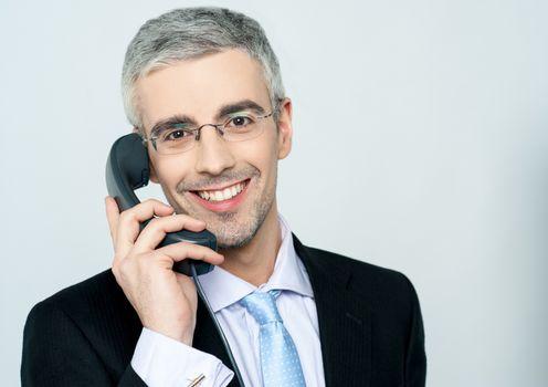 Businessman attending phone call
