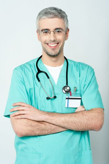 Smiling physician, arms crossed