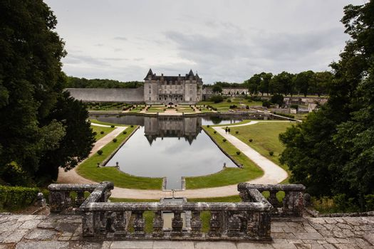Full view of La Roche-Corubon castle  with gardens and pond in Charente Maritime region of France