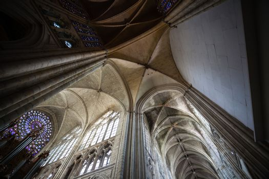 Wide angle view from the arhhitectural structure of the central nave in the cathedral of Tours in France