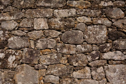 Wall of granite stone in a small village in the northwest of Spain