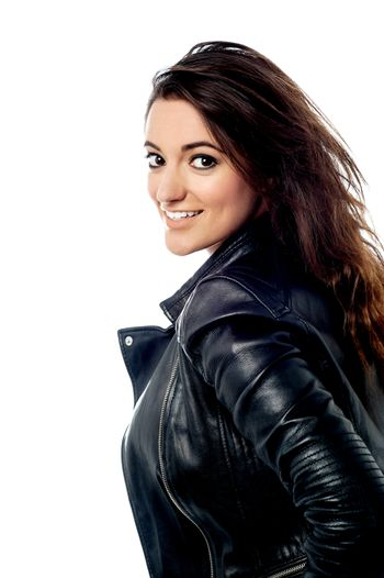 Dashing young girl in leather jacket