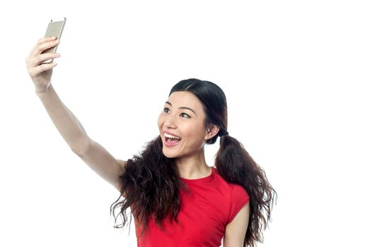 Excited girl using front camera to click self