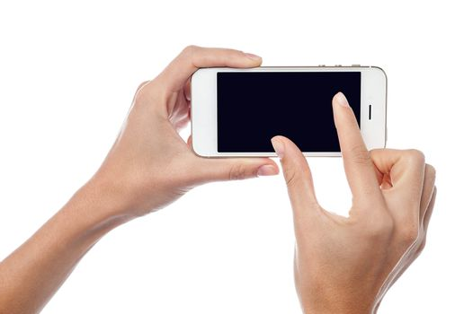 Fingers zooming in on cell phone