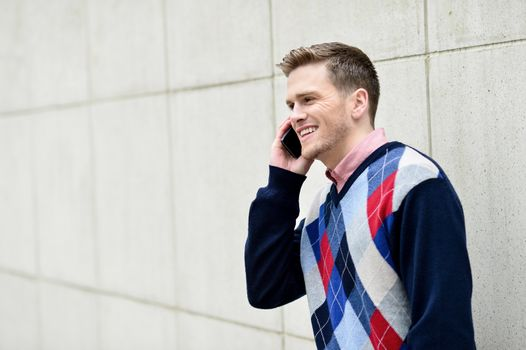 Young man busy in a phone conversation