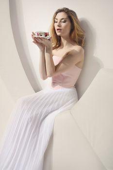 Delicate woman resting at tea