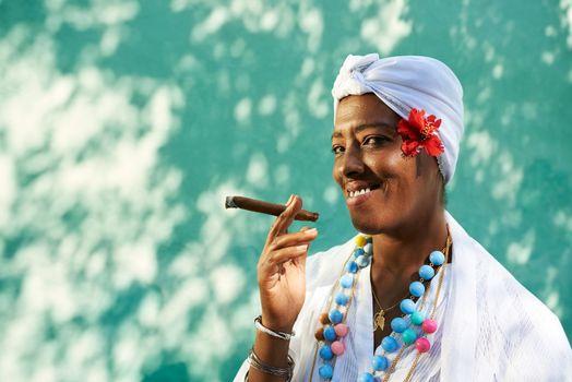 Portrait of cuban black woman smoking cigar