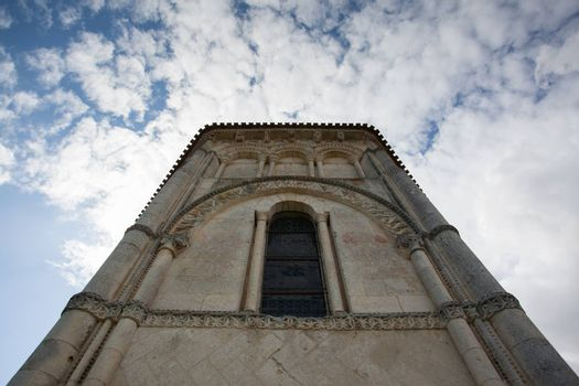 Abse view of the romanesque Retaud church,Charente, France