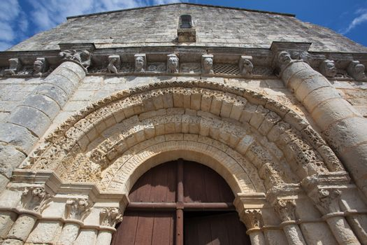 Archivolts detail in the  main entrance of the romanesque Retaud church,Charente, France